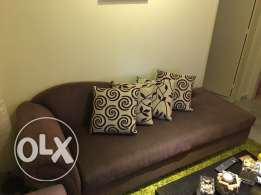Second hand couch with a built in store space in a very good condition couch