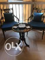 Two chairs plus a round table black color