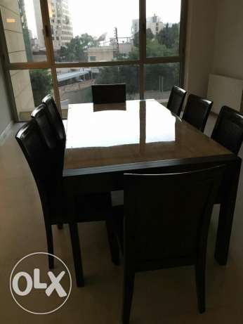 For sale dining table ,8 chairs ,dressoir and corner cabinet