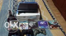ps3 with 5 cds and 3 controllers for sale