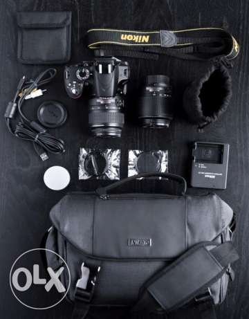 canon d3200 with lens and full black body