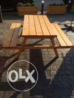 Outdoor wooden table with seats