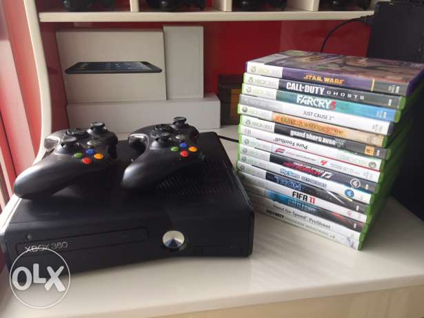 xbox 360 with 2 controllers and 15 games
