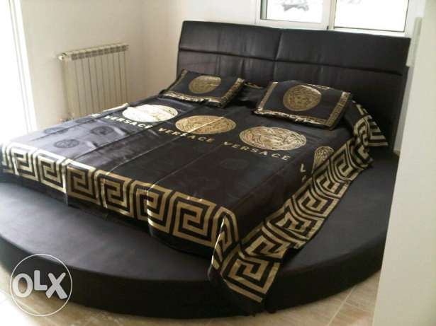 Brand new King Round black bed with mattress new with plastic package