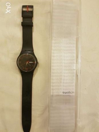 Swatch Black and Red Watch with five month remaining warranty