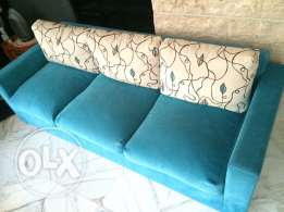 3 seated blue couch