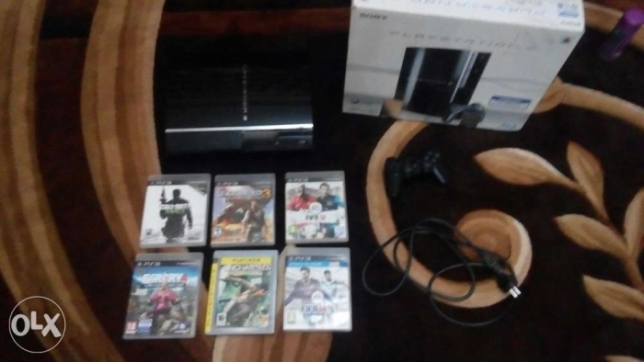 PS3 + CDs + controller + power cable