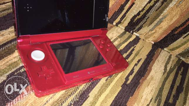 3ds red new with 1 cd and 1 sdcard