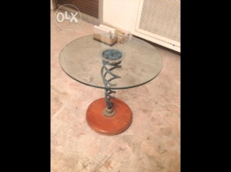 2 glass,fer forge and wood tables very good condition