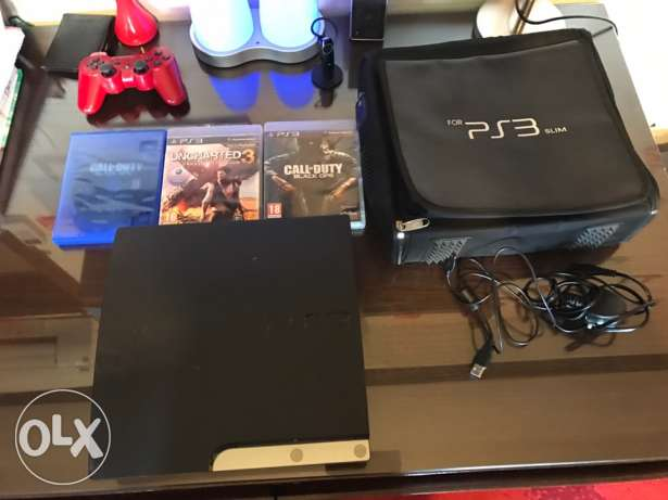 PS3 in very good condition with mic, bag, 4cds