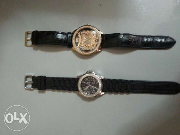 1 guess watch = 30,000 LL juicy couture watch=30,000LL both =50,000LL