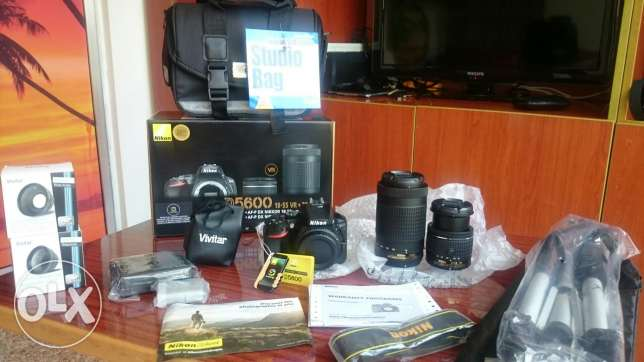 Nikon Newest D5600 BRAND NEW never opened + 2 lenses and many more