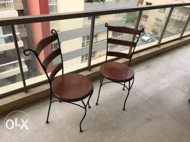 Four wrought iron and wood garden chairs
