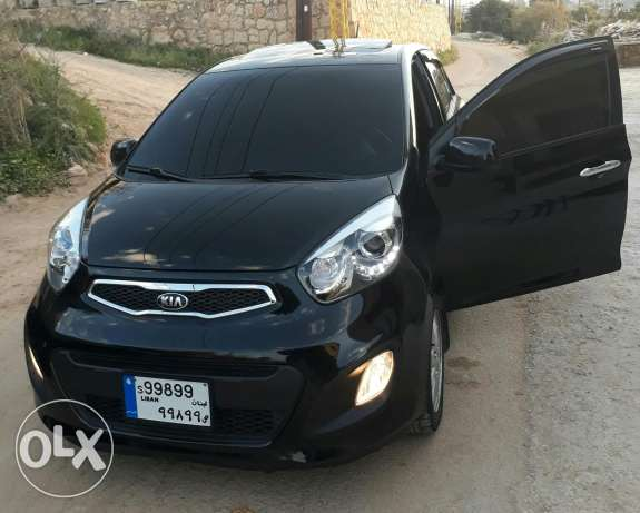 Kia picanto n:1 full fat7a airbag bluetooth 4 kahraba Airbag only39000