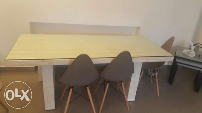 Table with 4 chairs and 1 bench