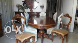 Wooden diner table + 8 chairs + 3 big wooden dressoirs