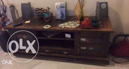 Cabinet that has a vintage antique style. Can be used as a TV set cabinet