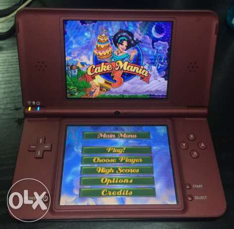 Nintendo DSI XL with R4 card that has 28 games