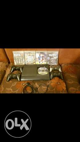 ps3 ultra slim with 4 joysticks and 4 cds