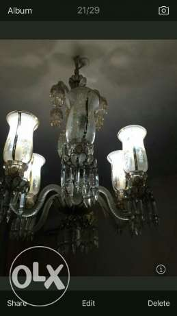 both be 85000 ...chandeliers with gold water سبتية -  2