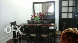 Selling dining table 8 chairs with dresser cause of travelling