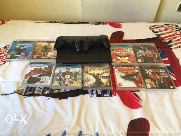 PS3 with 2 controllers and 9 games