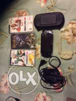 psp with cover and 3 original cds and charger for 50$