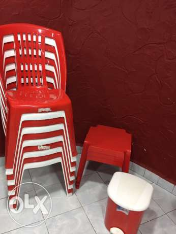 Plastic chairs, tables, & garbage
