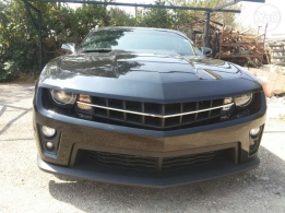 Chevroli camaro ajnabiyi super clean black jild black low milege 33alf