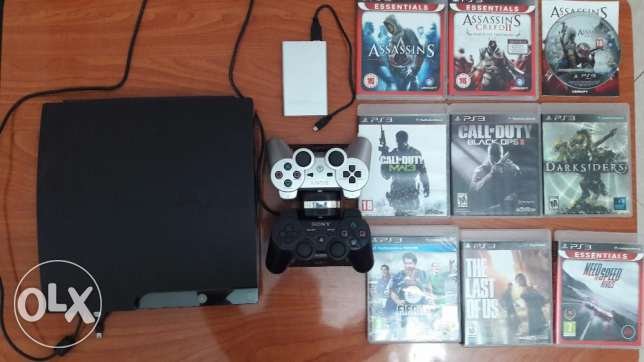 Play station 3 console + 2 controllers +9 games