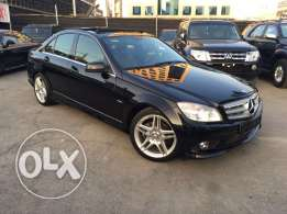 Mercedes C200 CGI 2010 Black/Black Too of the Line AMG Kit Panoramic!