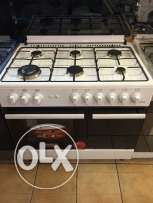 gas oven 6 eyes (new in box)