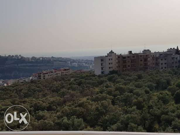 Apartment for sale in mansourieh. Unblocked view