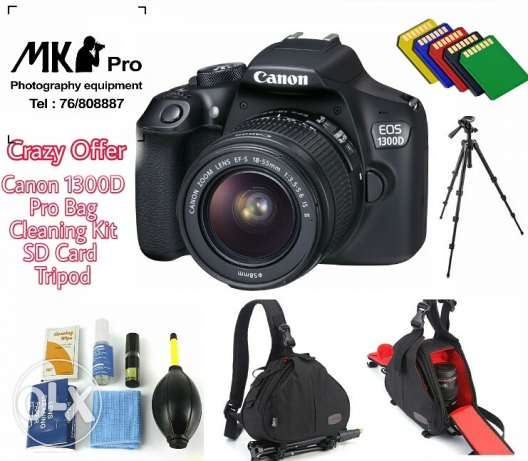 Canon 1300D kit with lens tripod bag cleaning kit sd card
