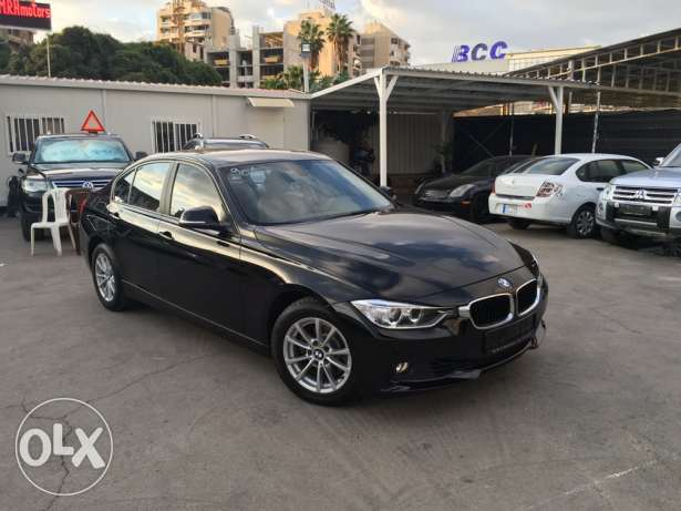 BMW 320 Black 2012 Fully Loaded in Showroom Condition! بوشرية -  1