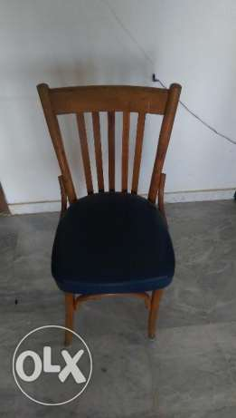 Wooden chair with leather cover. Good condition. 4 are available