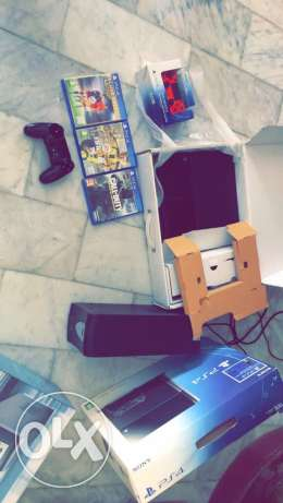 used ps4 ( excellent condition ) + 2 joysticks +3 Cds+ UPs