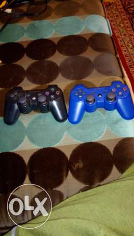 PS3 With 2 controllers 1 bule amd 1 black