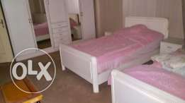 three single beds+ tow big closets + three corner tables+mirror table