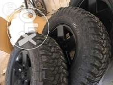 "4 x 33' tires and 17"" wrangler wheels for sale"