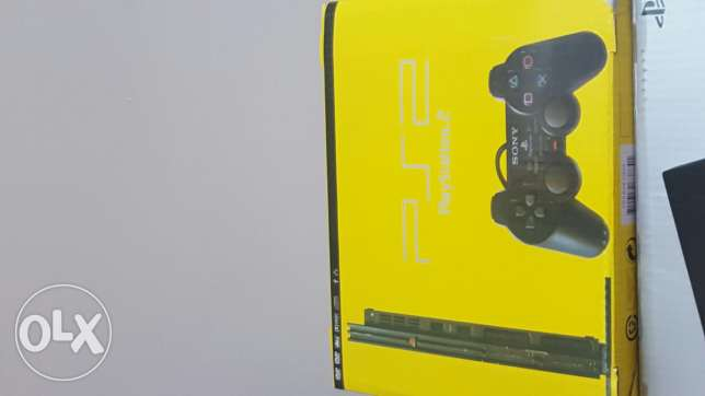 Ps2 with 2 joystick and 5 games