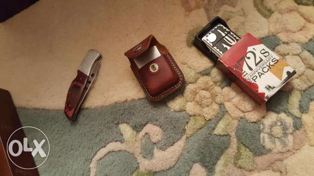2 lighters and a buck original knife