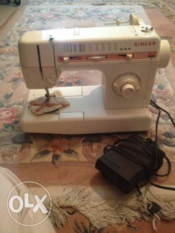 Singer Sewing Machine with Cover