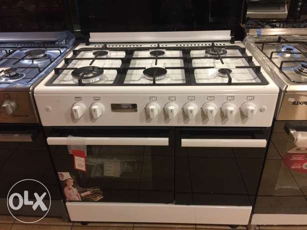gas oven 6 eyes with one year warranty ( new in box)