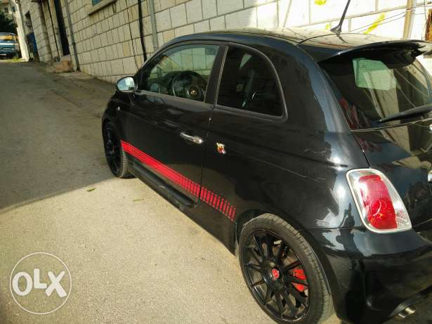 Fiat500 Abarth Esseese black on black for sale due to travel.