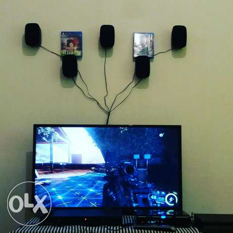 """Ps4 with tv 32"""" and surround system with dvd"""