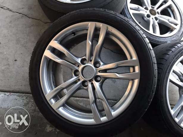 "2015 BMW 328i 18"" OEM wheels and tires, factory rims"