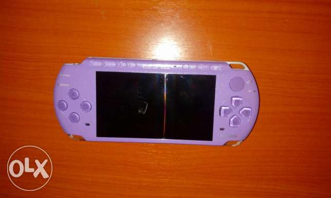 Purple PSP Slim 2010 In Perfect Condition Not Used (With Charger)