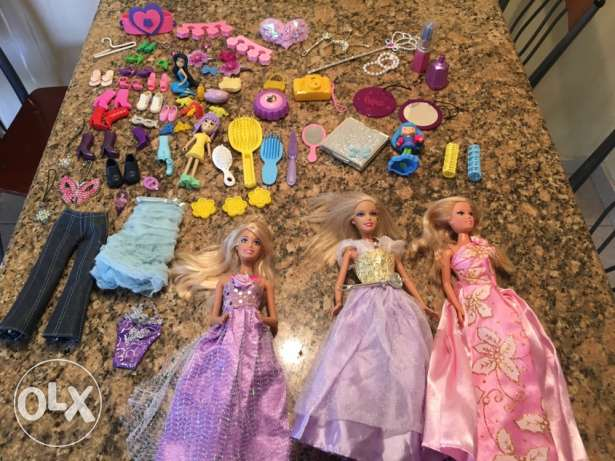 3 Barbies and accessories more than 40 pcs .
