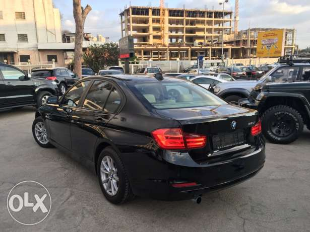 BMW 320 Black 2012 Fully Loaded in Showroom Condition! بوشرية -  5
